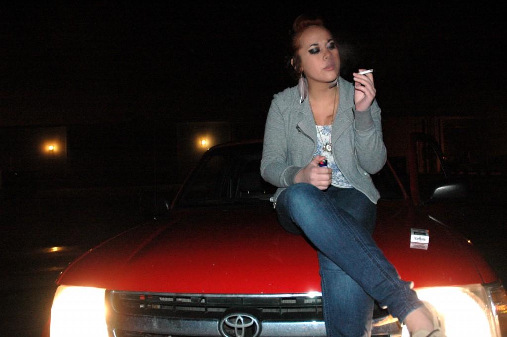 Shaemarie Skaggs enjoys a cigarette
