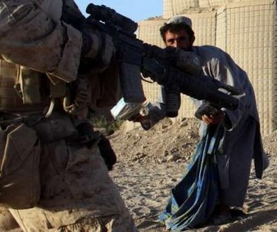 An Afghani clears away rubble, but not fast enough.
