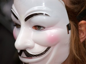 This young woman's gender has been wiped away by the Guy Fawkes mask and turned totally androgynous.