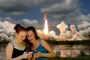 Two young girls disregard the final space shuttle launch at Cape Canaveral, Fla.