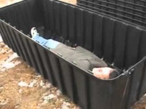 American Ebola patient is seen in plastic Fema camp coffin.