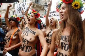 femen muslim haters 300x198 Members from the topless womens rights group Femen, take part in a demonstration near their training camp in Paris