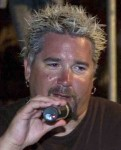 Guy Fieri limply hold onto the microphone at the national Homophobia Awareness Association's yearly meeting. Source: Wikileaks