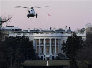 An emergency escape helicopter approaches the White House Friday morning as militias assemble at the gates