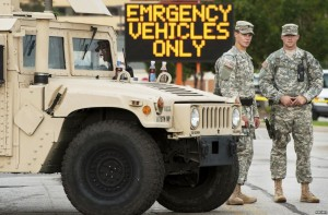 Roanoke County Va. police officers cower behind one of only four humvees, and await public insurrection.