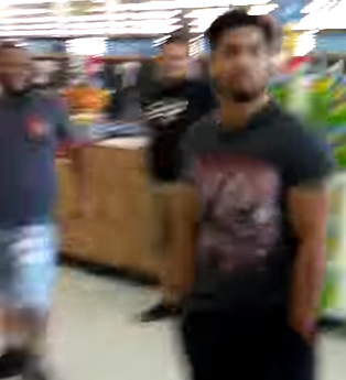Rare footage shows two gangstalkers caught on film in a Linden, New Jersey Walmart. The man in the background is not involved.
